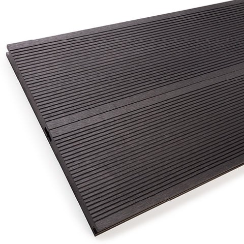 Solid composite decking for commercial settings