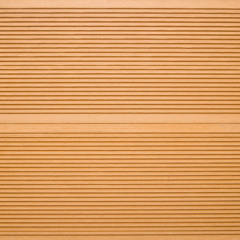 Close-up showing the texture of our standard grooved composite decking