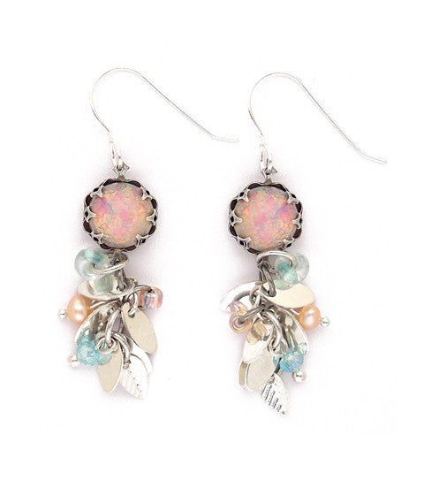 "Silver plated leaves dangle beneath a gorgeous pink opal glass cabochon. Peaking out form the leaves are freshwater pearls, crystal and glass. Sterling silver earwires. Approx 2"" long."