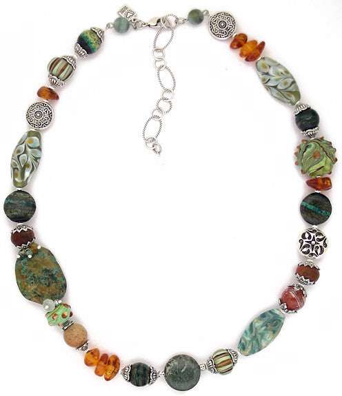 "Big chunky necklace with a gorgeous, earthy combo of jaspers, amber, jade, agate and glass. The metals are pewter, and sterling plated and antiqued brass. Approx 20.25"" long with a 3"" extension."