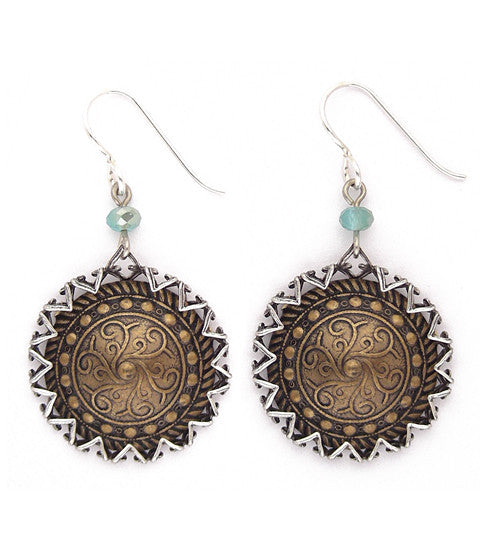 "Fabulous antiqued brass discs captured in antiqued sterling plated settings, with lovely sea-colored faceted crystals. Silver-fill ear wires. Approx 1.75"" long."