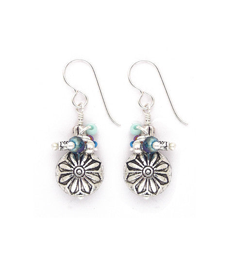 "Flower stamped pewter topped with glass, faceted crystal and rubber beads. Hand wrapped. Silver fill ear wires. About 1.5"" long."