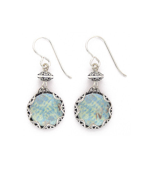 "Art paper is captured under a bubble of crystal clear glass with a pewter bead above, allowing for a little movement. The ornate vintage inspired bezel is sterling plated and antiqued brass. Silver fill ear wires. 1.5"" long"
