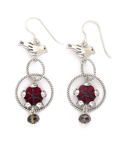 "Sweet pewter birds hover above sterling plated and antiqued brass rope rings with a deep red glass flower and a dark olive/grey crystal. Silver fill ear wires. Just over 2"" long"