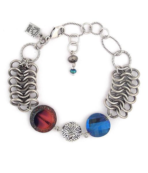 "This fun little bracelet almost looks like a cuff when you put it on. A couple of fabulous chains and some nicely cut glass and crystal and you're ready to rock! Silver plated and antiqued brass, pewter, glass and crystal. 6""-8"" long"