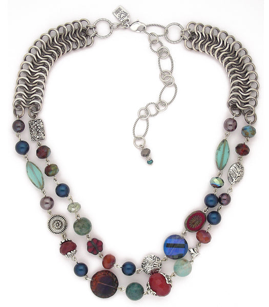 "What a great collection of beads! Crystal, glass, agate, pewter and Swarovski petrol colored glass pearls. The fabulous chain wears almost like a collar and feels great on. Sterling plated and antiqued brass. 18""-20"""