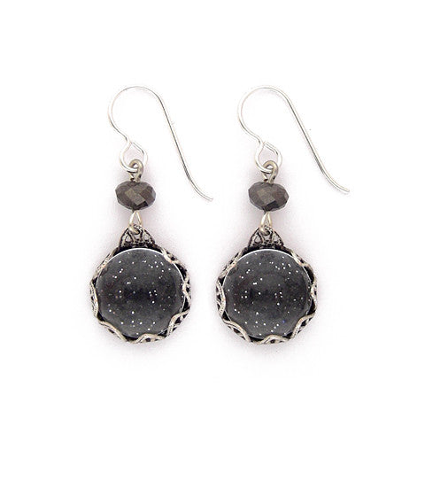 "Sparkly art paper under a clear glass dome - very night sky looking! The ornate silver plated and antiqued brass setting is vintage inspired and the nicely facetted crystal bead adds a little extra glow. Silver fill ear wires. 1.5"" long"