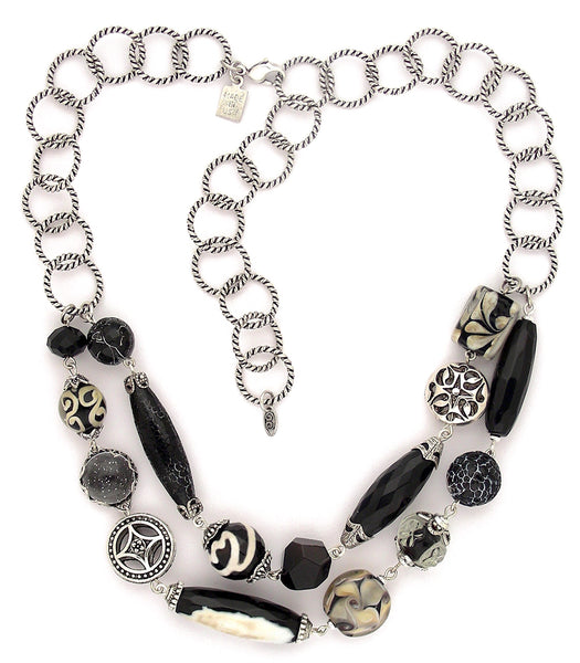 "A stunning collection of significant beads make up this 2 strand statement piece. Multiple agates, druse, handmade glass, art paper and pewter hang together between sturdy silver plated and antiqued rope style rings. Can be clasped anywhere on the chain 14"" -20"""