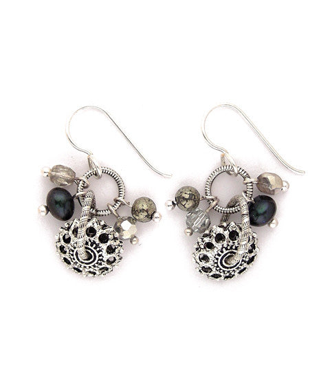 Pewter wheels hang from silver plated and antiqued brass textured rings. Surrounding them are facetted glass beads, pyrite, and dyed freshwater pearls. Silver fill ear wires.