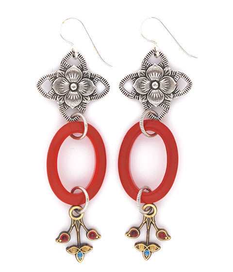"A bold statement earring - oval glass in deep red, hand enameled brass and a sterling plated and antiqued cross shape with a flower inset. Silver fill ear wires. 3"" long."