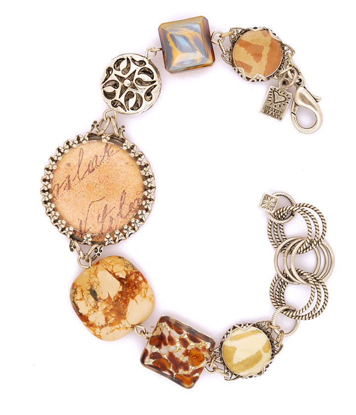 "Beautiful, vintage inspired components made into a bracelet that makes a statement! Jasper, art paper, pewter, glass bubbles, buttons, pewter, glass, sterling plated and antiqued brass. 7.25""-8.5"""