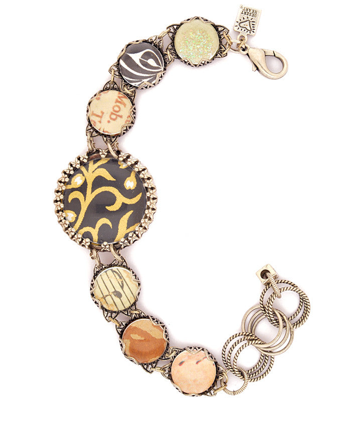 "I love the mix of art papers on this fantastic 'bubble bracelet'. Vintage inspired sterling plated and antiqued settings, pewter, glass bubbles. 6.75""-8"""