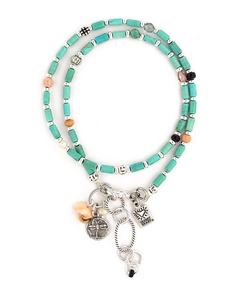 "Lovely, polished turquoise tubes are the basis for this multi-functional piece. Double wrap for a bracelet or wear as a necklace, if you like. Also includes glass, trade beads, shell, freshwater pearls and pewter. A sweet sterling plated/antiqued brass dragonfly charm adds, well, charm. 14.5""-16.25"""