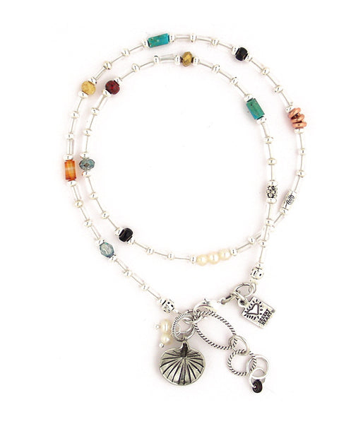 "A sweet, delicate looking (but strong!) offering with crystal glass beads, silver plated brass beads, copper, pewter, freshwater pearls, turquoise, and silver plated and antiqued brass chain. Very pretty. Bracelet or necklace. 15.5""-16.75"""