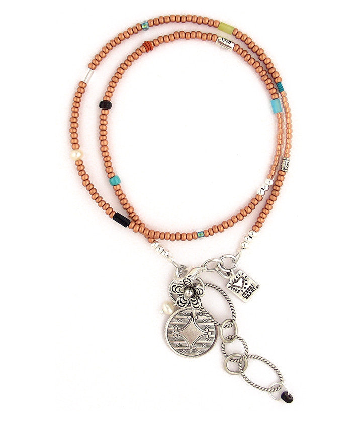 "Almost 200 little seed beads are strung together here with freshwater pearls, glass, various stones, rubber and pewter to create a light and lovely little 'go anywhere' double wrap bracelet - or wear as a necklace! 14.75""-17"""