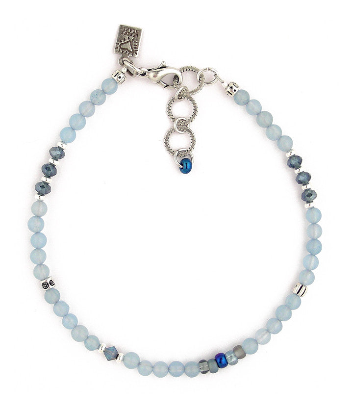 "Lovely to look at. Beautiful blue glass and crystal beads with a little bit of pewter and a sterling plated brass extender chain. 9.25""-10.5"""