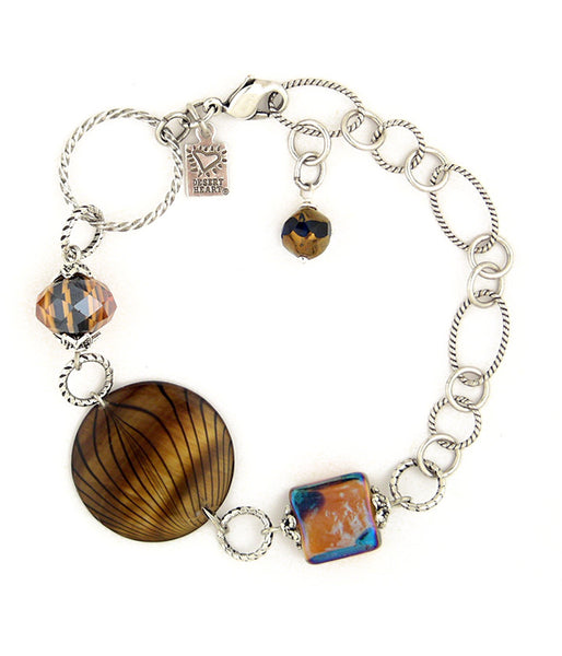 "Fun link bracelet with earthy, glitzy glass and a hand painted shell. sterling plated and antiqued brass. 6""-8.5"""