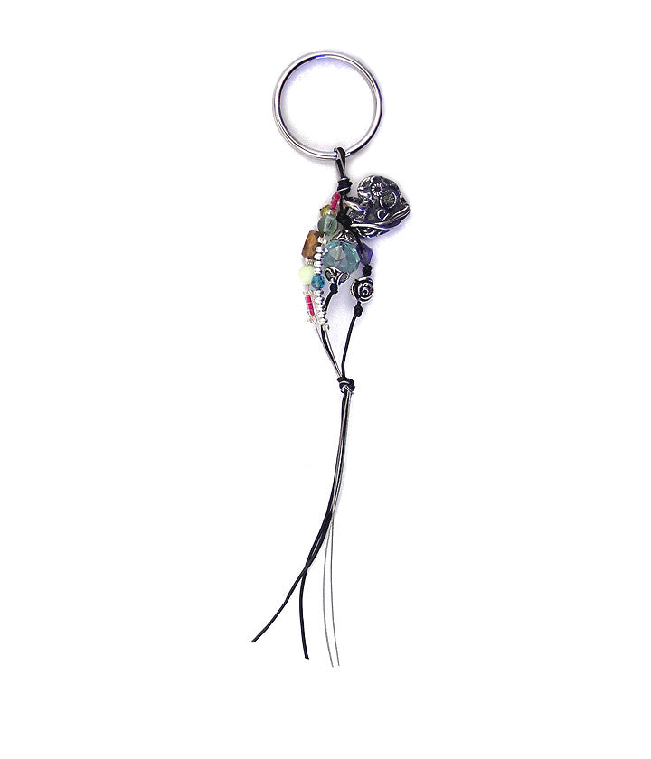 Hello Gorgeous! One of Deb's original design sterling silver hearts hangs from a combo of leather and tiger tail (nylon coated steel cable). It's surrounded by a colorful array of contemporary and vintage glass, crystal, pewter and sterling plated brass spacers.
