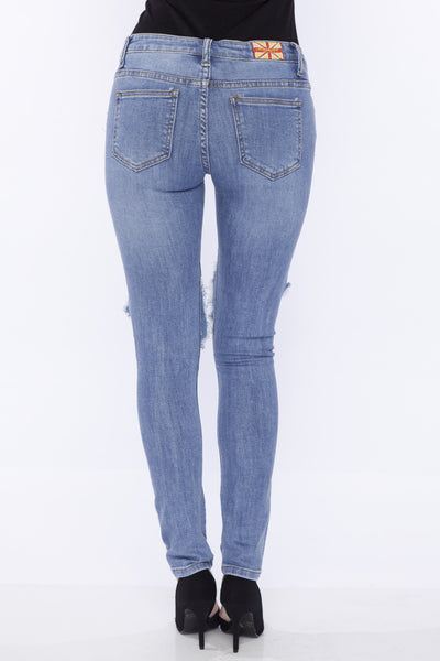 Mid Rise Medium Blue Wash Ripped Knee Hole Stretch Skinny Jean by Machine Jeans
