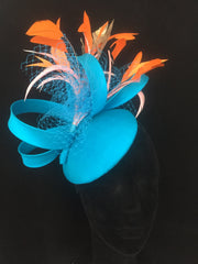 Strelitzia -Made to order Turqoise Blue silk small hat with burst of orange feathers and silk loops. - NOELEEN MILLINERY HONG KONG
