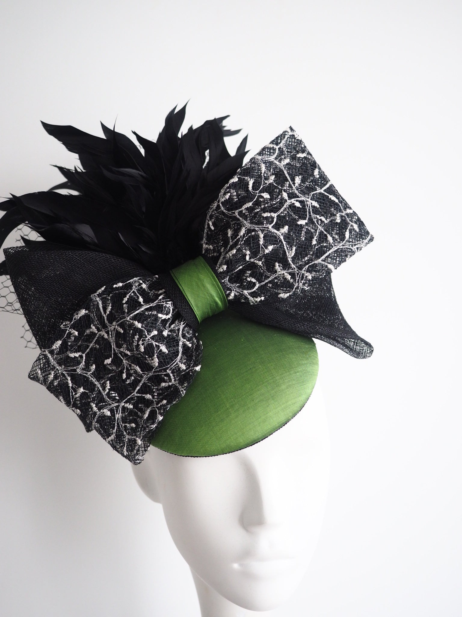 Clover - Green silk hat with black feathers and large bow - NOELEEN MILLINERY HONG KONG