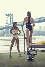 Cargar imagen en el visor de la galería, Back of Denise one piece black swimsuit in Black, Brooklyn Bridge Park, NYC.