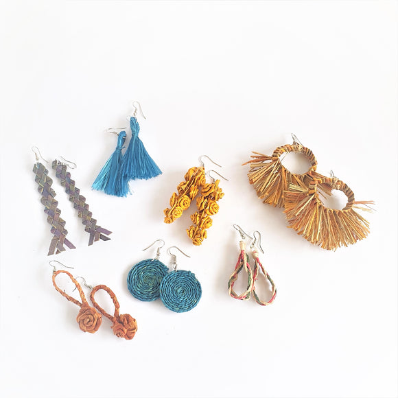 Assorted handcrafted earrings made with pandanus leaves in different styles and colors