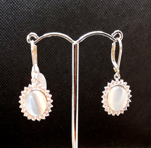 Faux moonstone earring in sterling silver with rhodium finish and cubic.surrounded by micro set cubic
