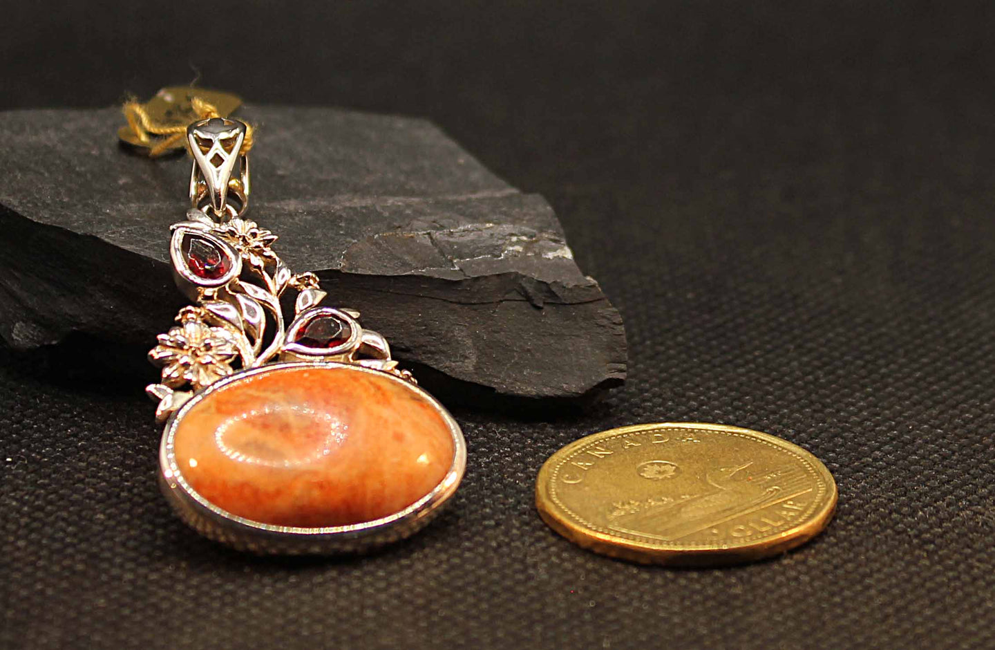 Bamboo coral pendant with garnets set in sterling silver