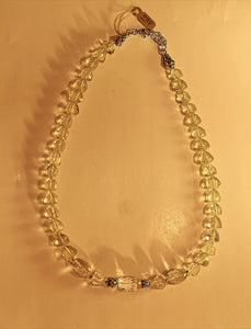 Green amethyst faceted stone necklace with sterling silver beads and extending chain.