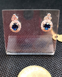 Blue sapphire colored cubic stud earrings in sterling silver with rhodium finish