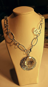 Sterling silver with rhodium finish necklace with filagree medallion and clear quartz pendants