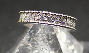 5mm wide eternity ring, sterling silver with rhodium finish.