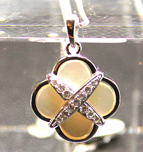 Mother of pearl 4 leaf clover pendant in sterling silver with rhodium finish and cubic