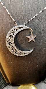 Star and moon necklace in sterling silver with rhodium finish set with cubic