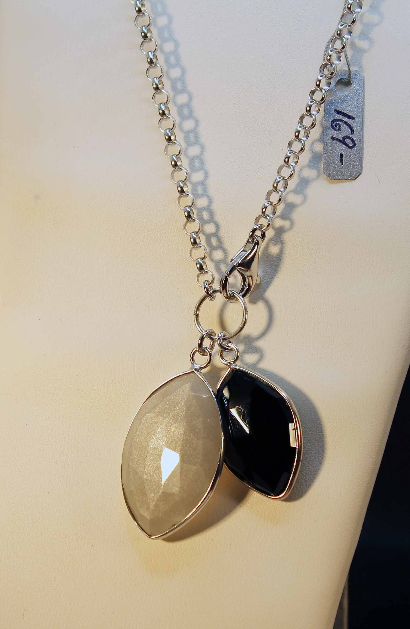 Sterling silver, rhodium finish necklace with grey moonstone and black onyx pendants