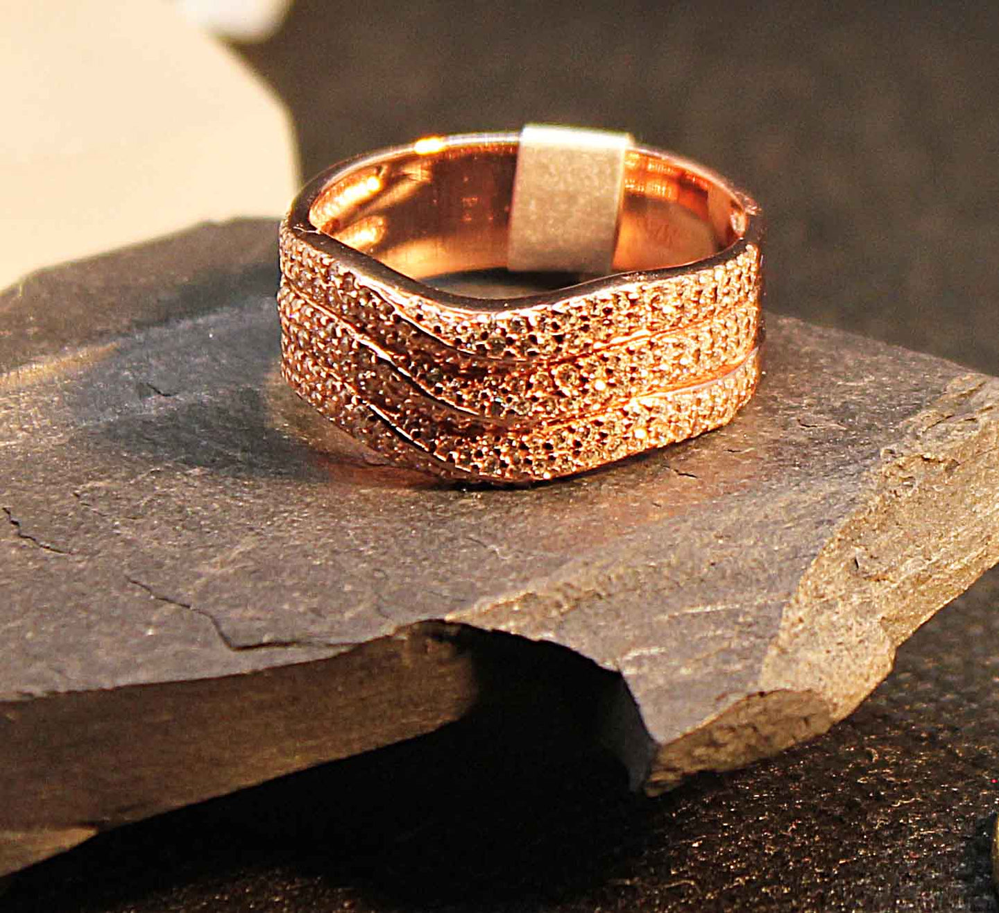 Rose gold plate on sterling silver wave ring set with cubic