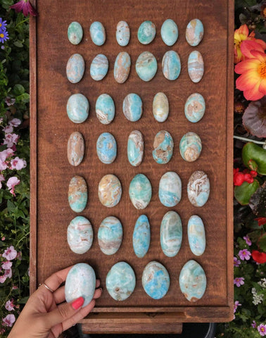Blue Aragonite pocket stones and palms