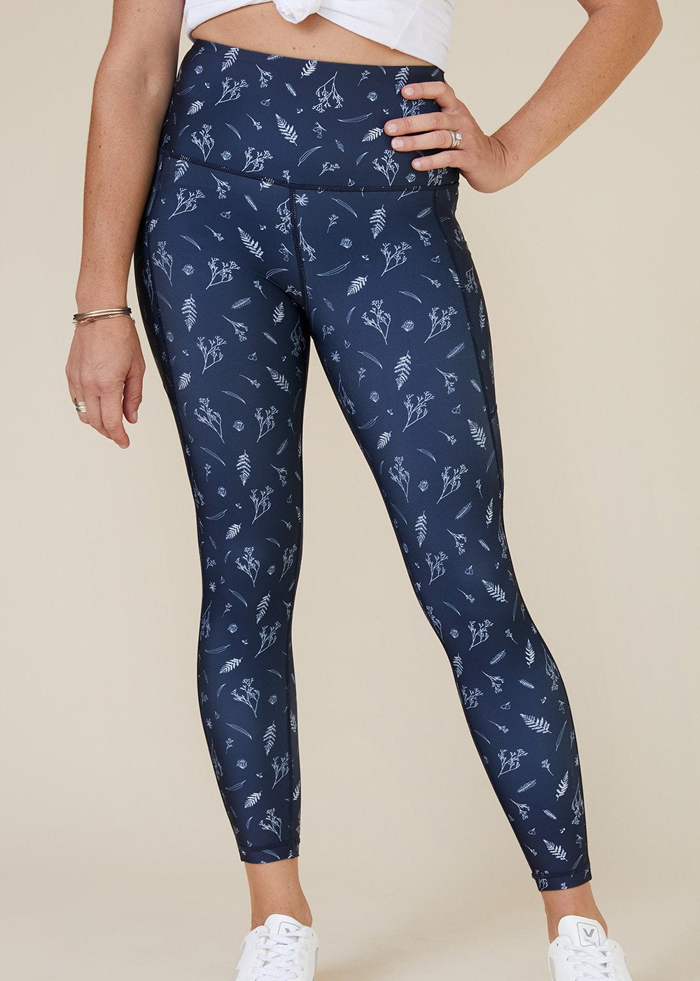 Sustainable Australian Navy Blue 7/8 ankle length leggings with side phone pockets with delicate floral botanical print in white?id=28046180155475