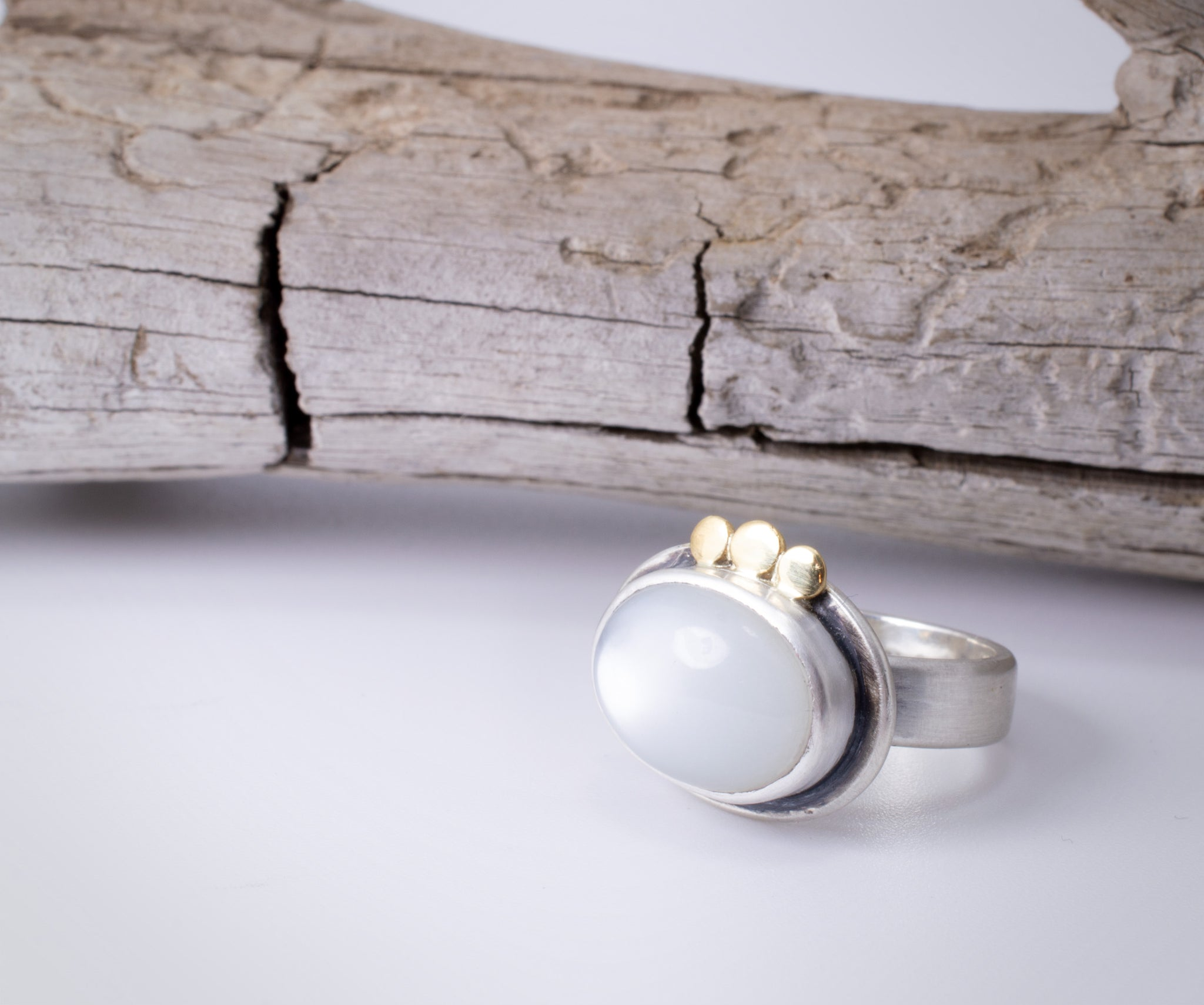 White Moonstone Ring in Silver with Gold Accents