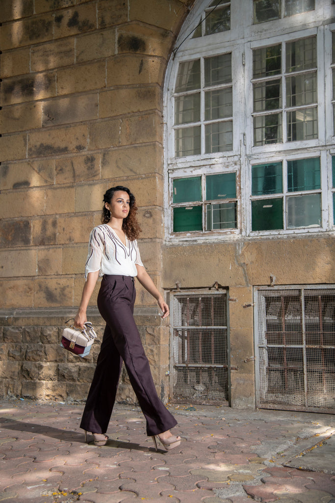White cord embroidered top with high waisted pants