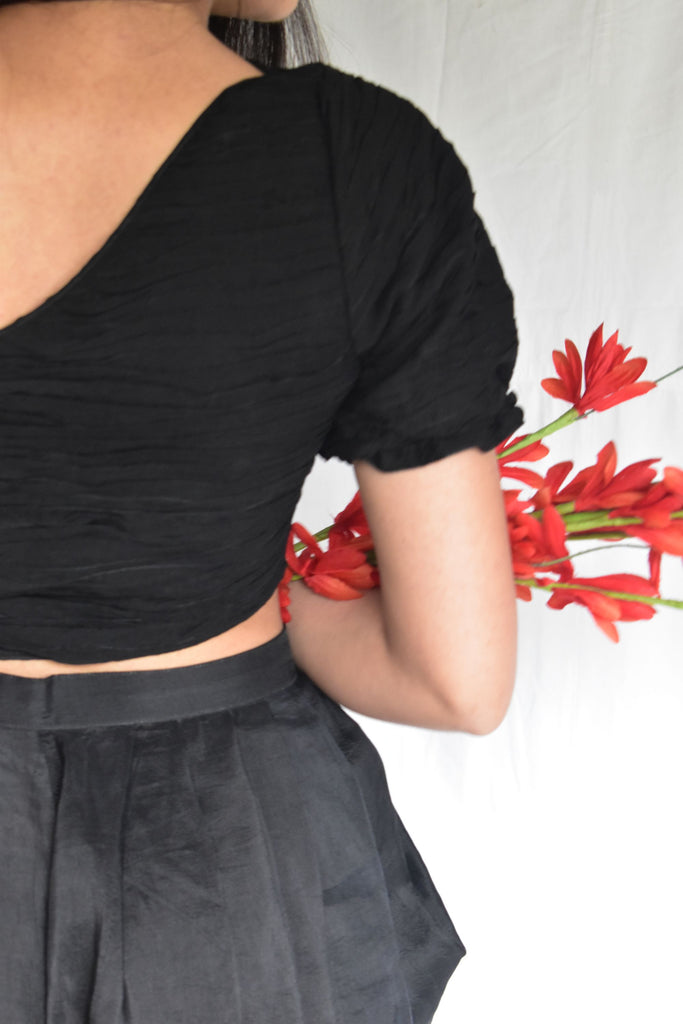 Black one shoulder top with black dhoti