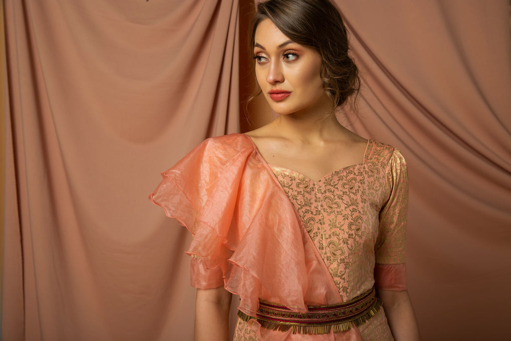 Brocade kurta with organza flared dupatta paired with sharara.