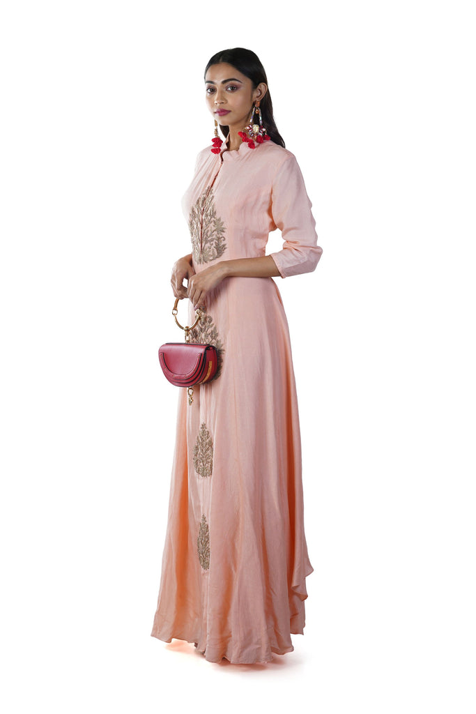 Peach Leaf Hand Embroidered Anarkali Gown. The gown is beautifully adorned with hand embroidery