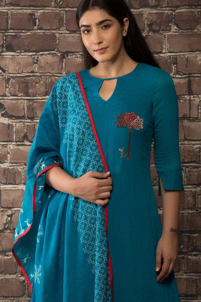 Teel blue linen georgette kurta  with matching pants and dupatta.