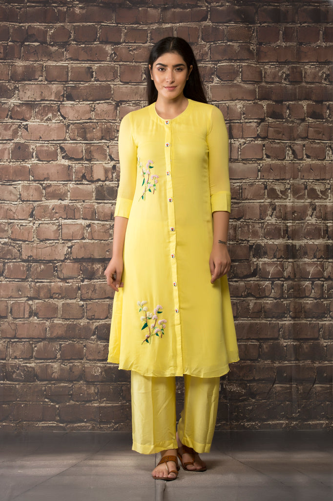yellow linen georgette kurta  paired with matching pants.