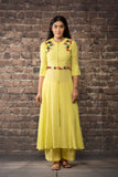 yellow linen silk dress kurta paired with matching pants.