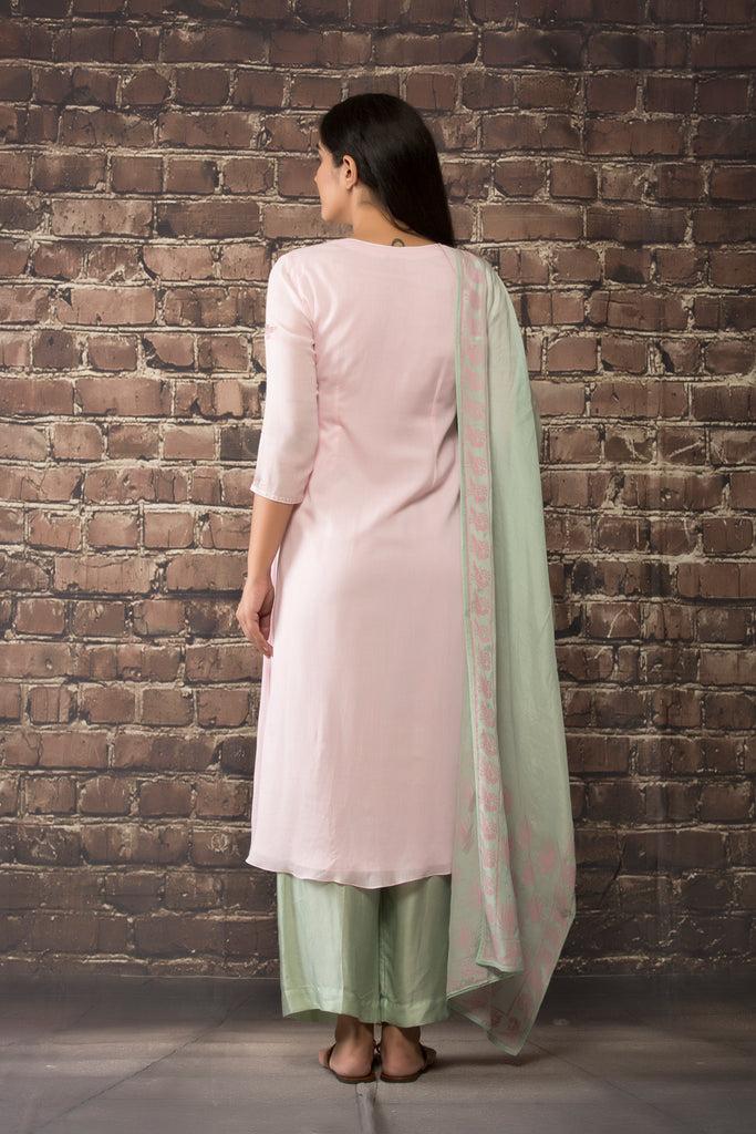 baby pink linen georgette tunic  paired with matching pants and dupatta.