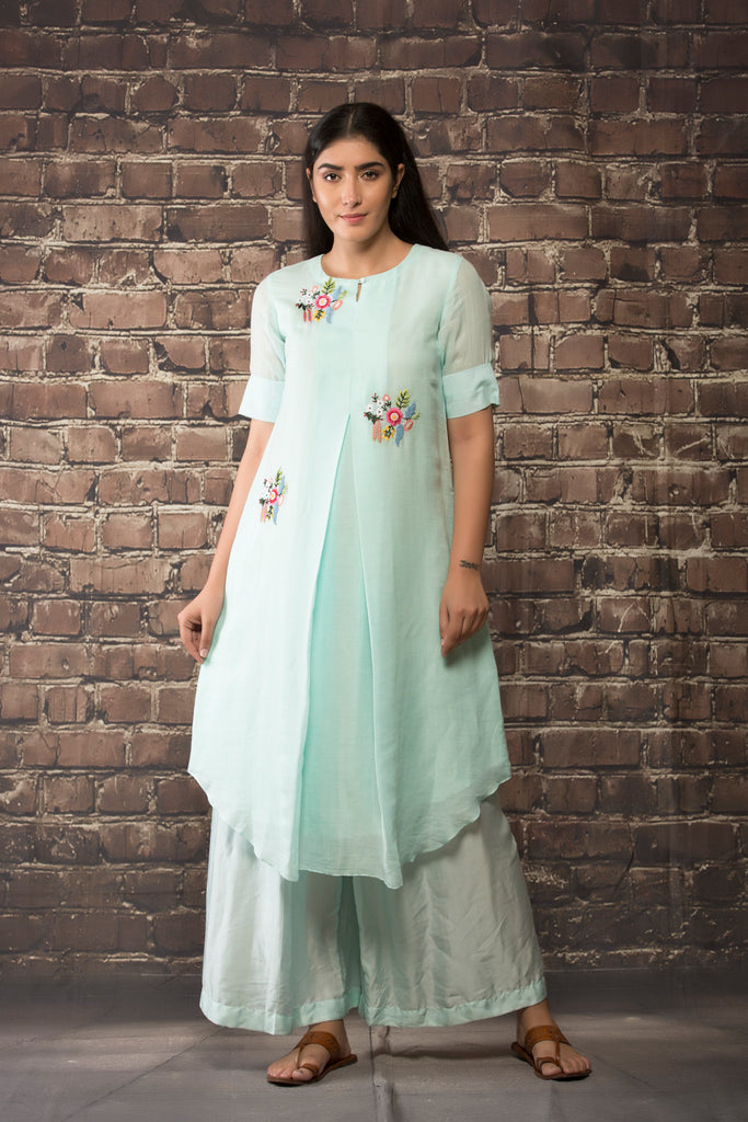 ice blue handloom linen twill kurta  paired with matching pants..