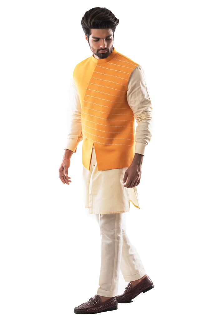 Yellow Asymmetrical Bandi with Katha and Challa Hand Embroidery. Paired With A Creamish Yellow Shirt Kurta and Narrow Fitted Pant Pajama.